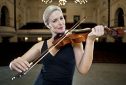 Woman playing violin in theater --- Image by © Olix Wirtinger/Corbis